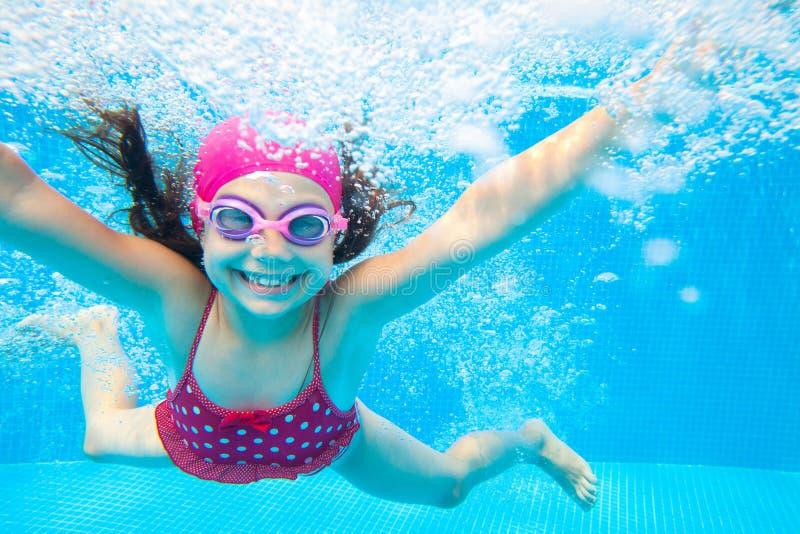 Girl swim in  pool stock image