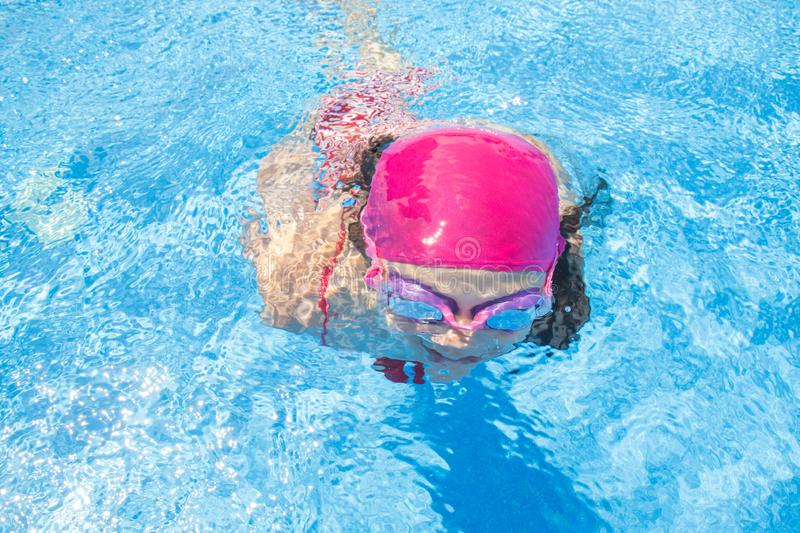 Girl swim in  pool stock images
