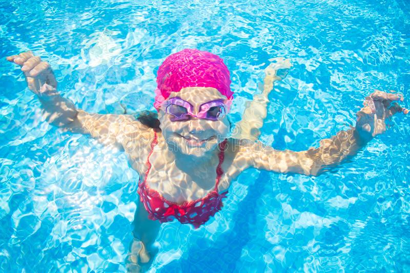 Girl swim in  pool stock image