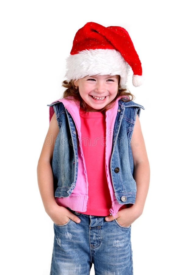 Download Little Girl In Denim Suit And A Hat Of Santa Claus Royalty Free Stock Photography - Image: 20486017