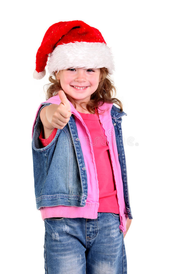 Little Girl In Denim Suit And A Hat Of Santa Claus Stock Photos