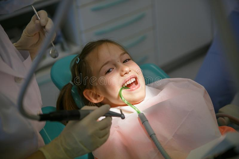Little girl at dentist office stock photography