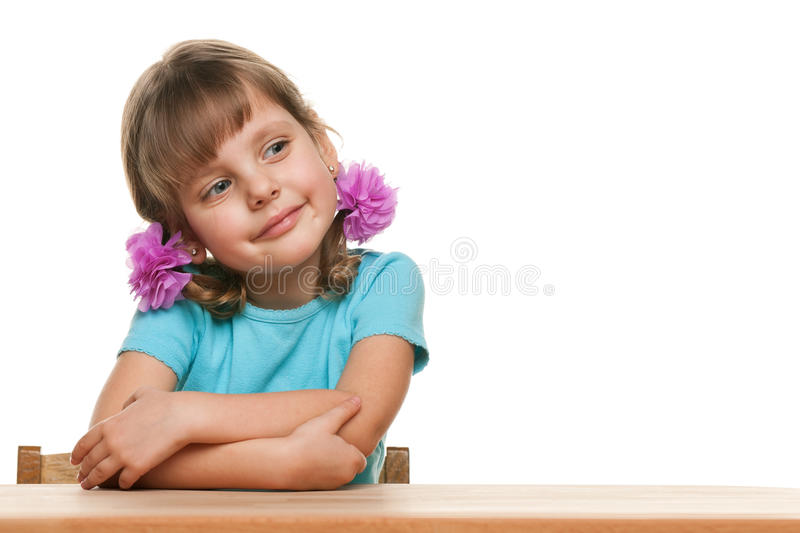 Little girl at the desk stock images