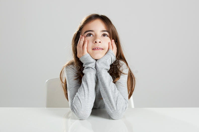 Little girl in a desk royalty free stock images