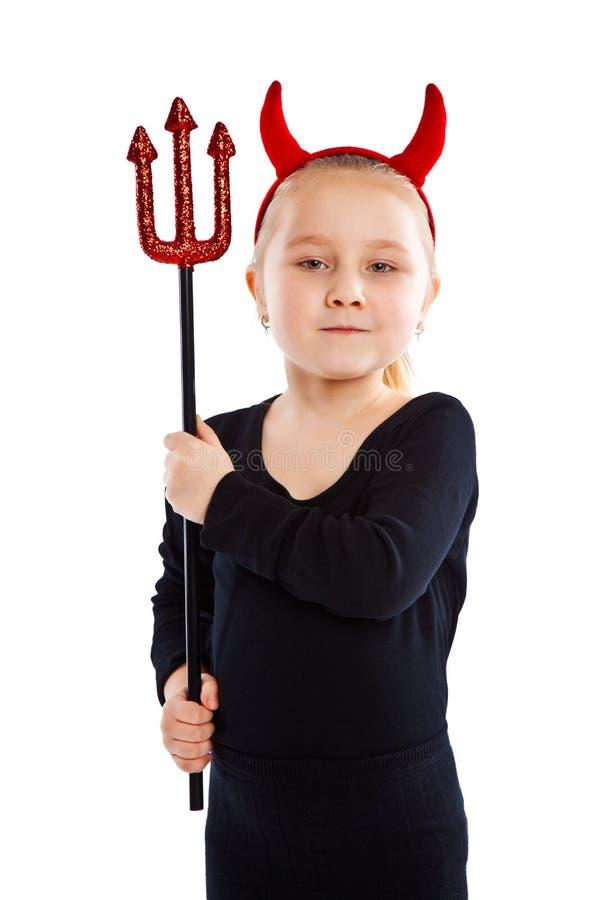 Little girl in devil costume. royalty free stock photos