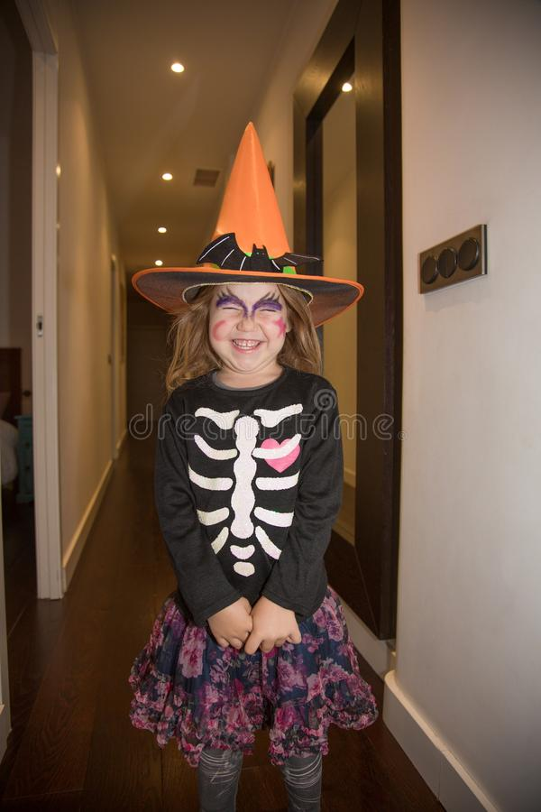 Little girl in disguise for Halloween laughing royalty free stock photo