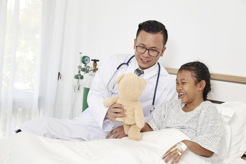 Little girl and doctor in hospital royalty free stock images