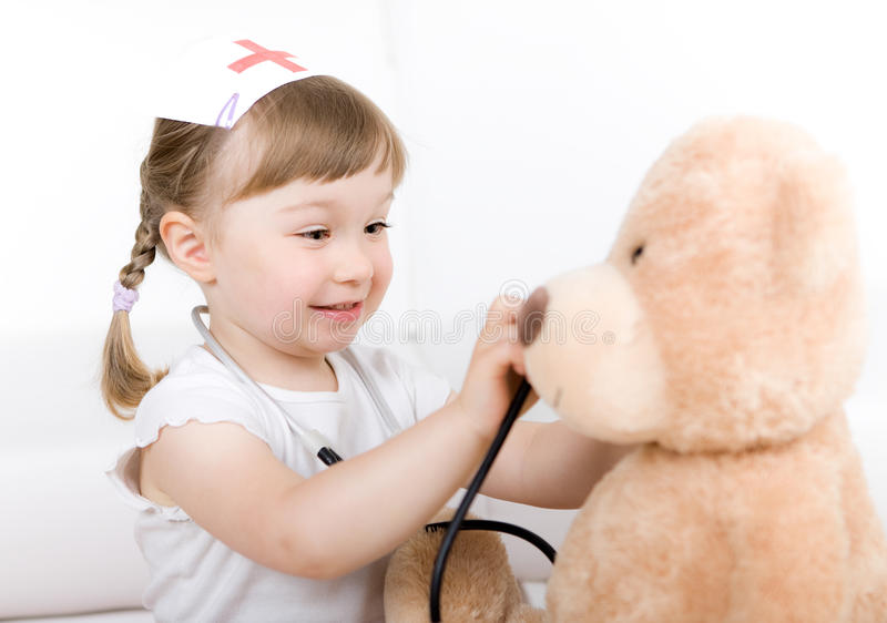 Little girl doctor with teddy bear royalty free stock photos