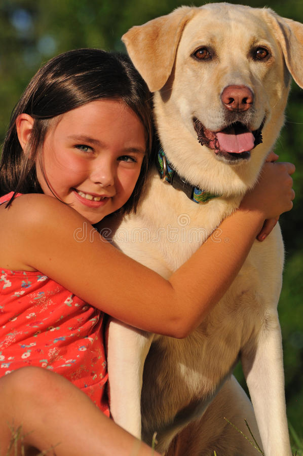 Little girl and dog friendship stock photography
