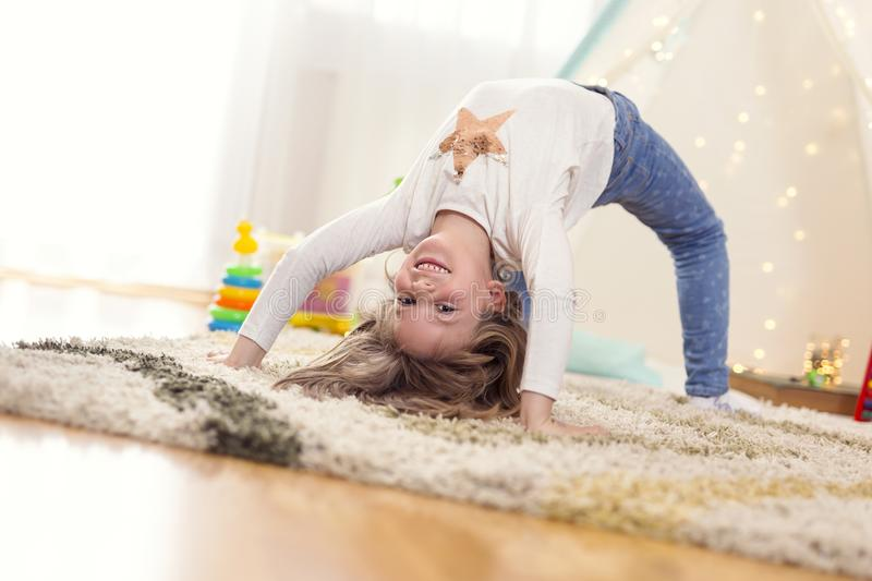 Little girl doing backbend stock image