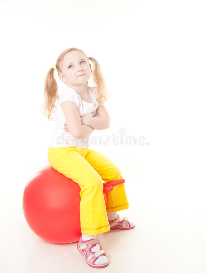 Little girl doing exercise with ball stock photo