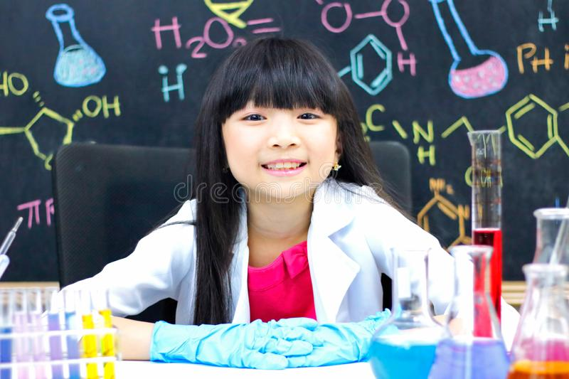 Little girl doing experiments in the laboratory. Science and education stock photography