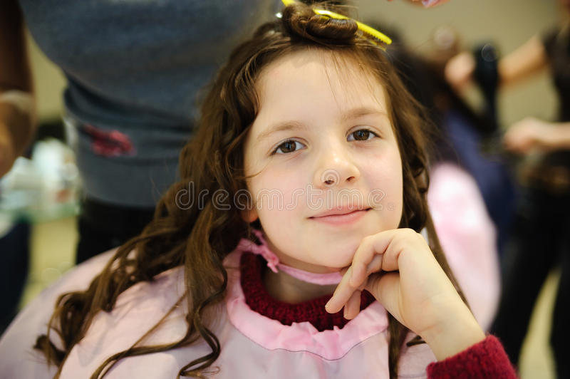 The little girl doing a hairdress