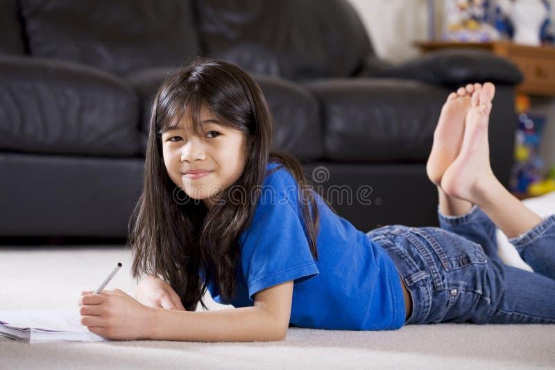 Little girl doing her homework stock image