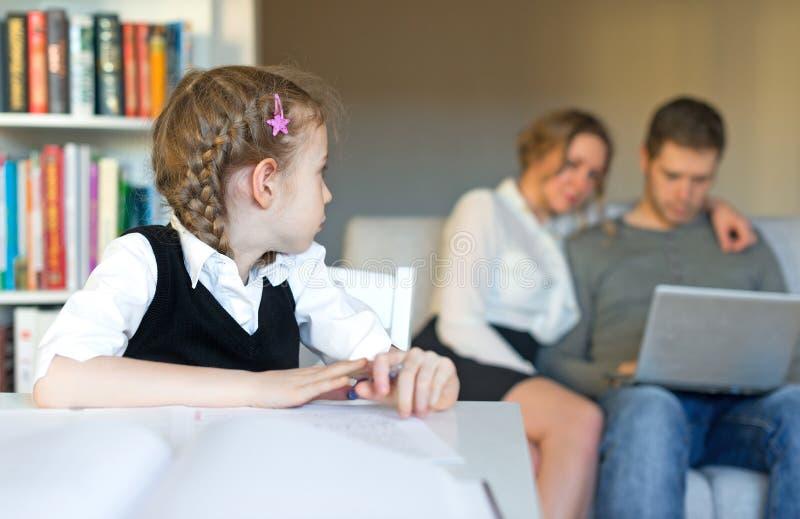 Little girl doing homework. stock image