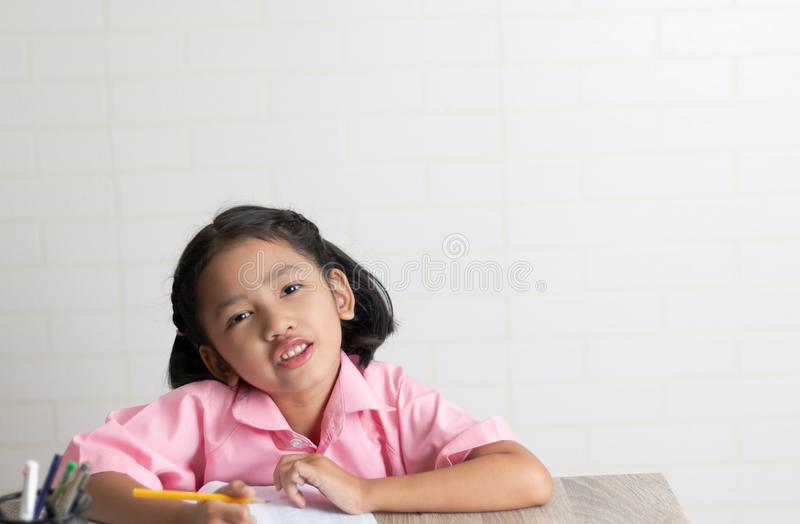 The little girl is doing homework royalty free stock photos