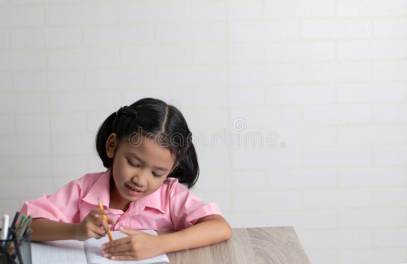 The little girl is doing homework happy royalty free stock images