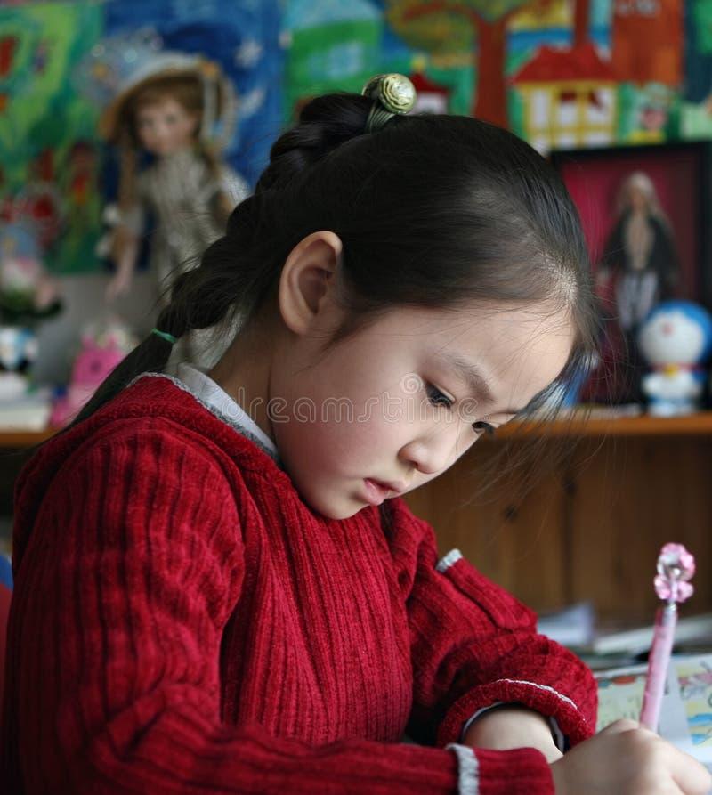 Little girl doing homework at home royalty free stock photo