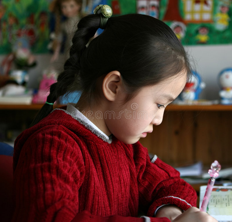 Download Little Girl Doing Homework At Home Stock Photo - Image: 8160416