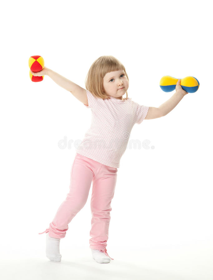 Little girl doing sport exercises royalty free stock photo