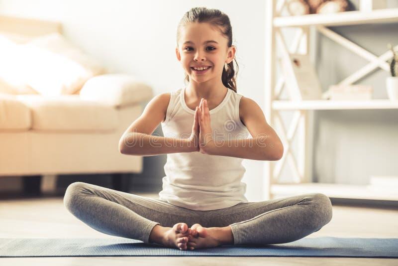 Little girl doing yoga stock photo