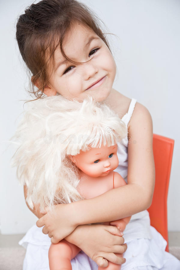 Little Girl With A Doll Stock Image