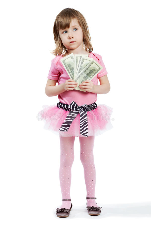 Little girl with dollar banknotes in hands stock image