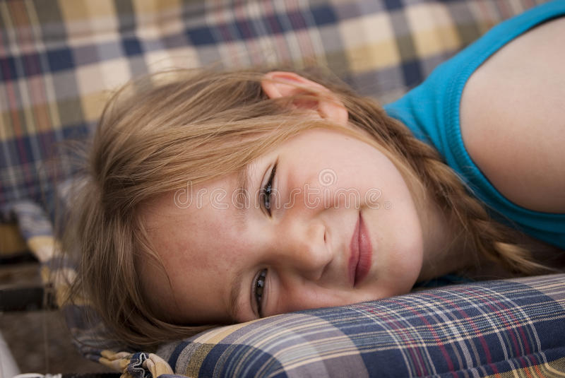 Little girl dozing on a porch swing