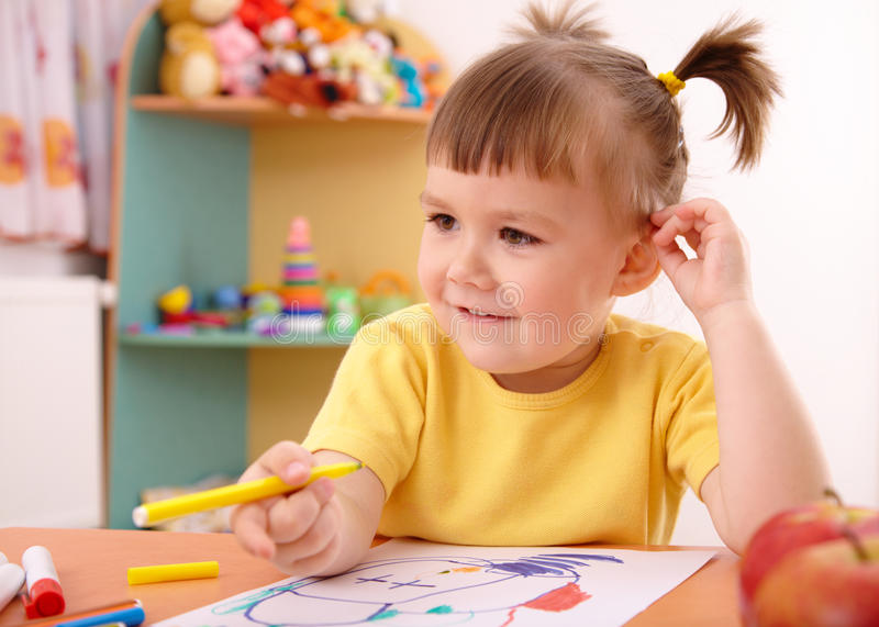 Little girl draw with felt-tip pen royalty free stock photos