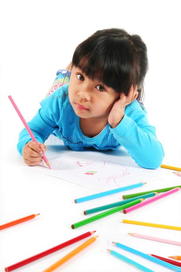 Little girl drawing stock photos