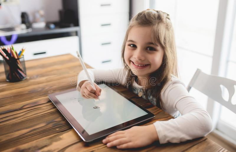 Little Girl Drawing Digital Picture On Tablet royalty free stock photos