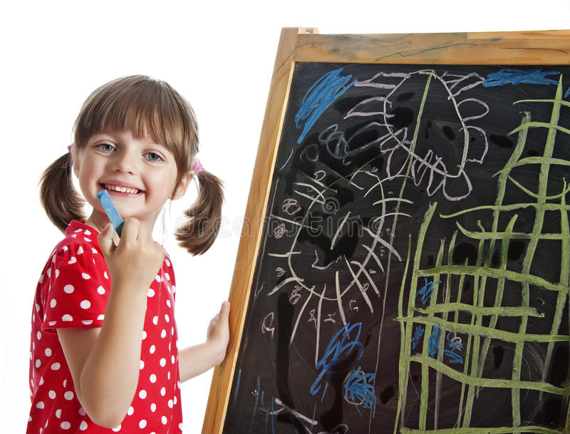 Little girl drawing picture with chalks royalty free stock images