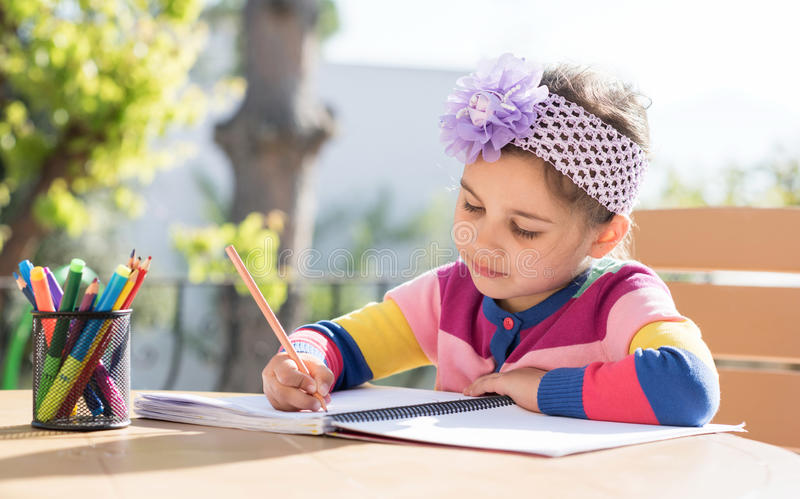 Little Girl Drawing Picture Outdoors royalty free stock photos