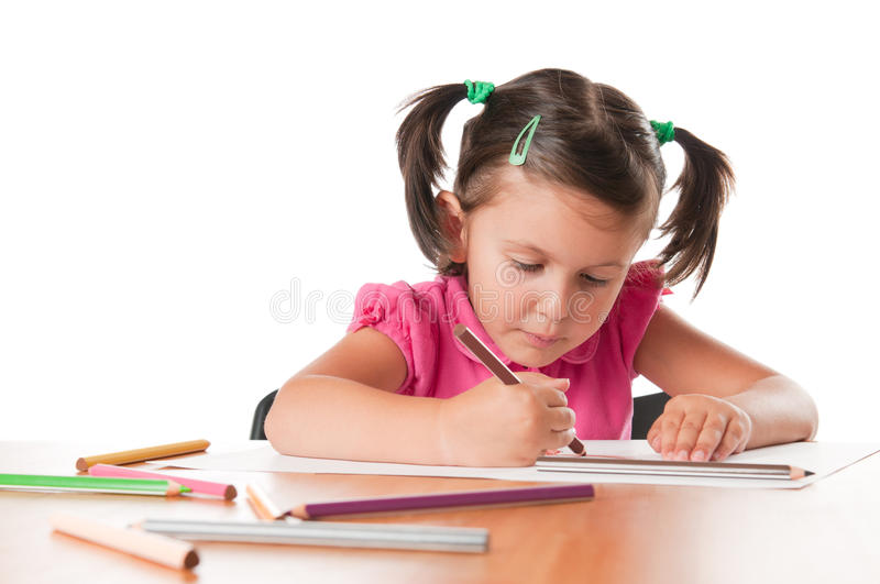 Little girl drawing pictures stock images