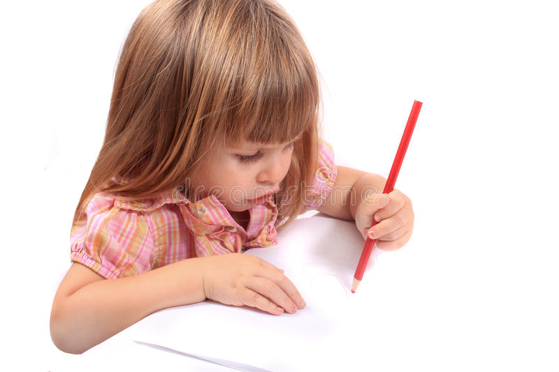 Little girl drawing pictures stock photography