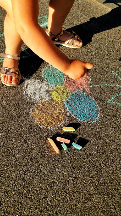 the little girl draws the crayons royalty free stock image