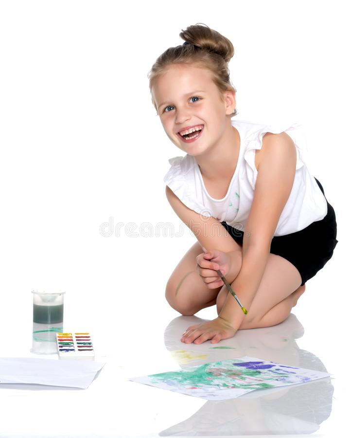 A little girl draws paints on her body royalty free stock images