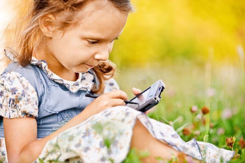 Little Girl Draws On PDA Stock Photography