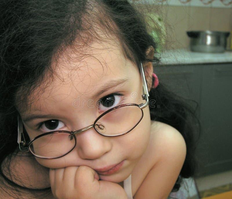 Little girl dreaming stock photo