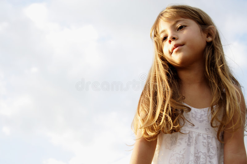 Little girl dreaming royalty free stock photos