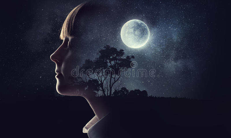 Little girl dreaming with closed eyes . Mixed media stock photos