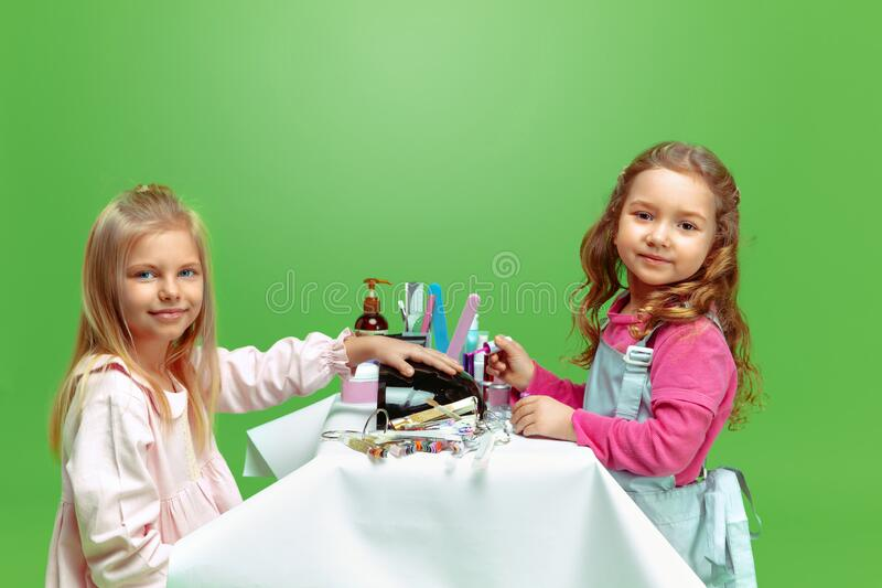 Little girl dreaming about future profession of nails manicure artist stock image