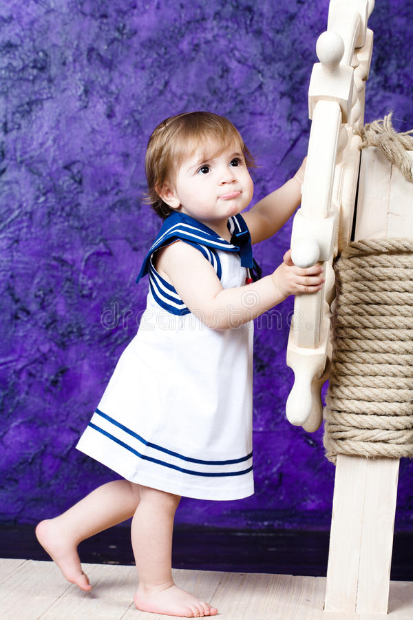 Little girl in a dress in sailor's style stock photography