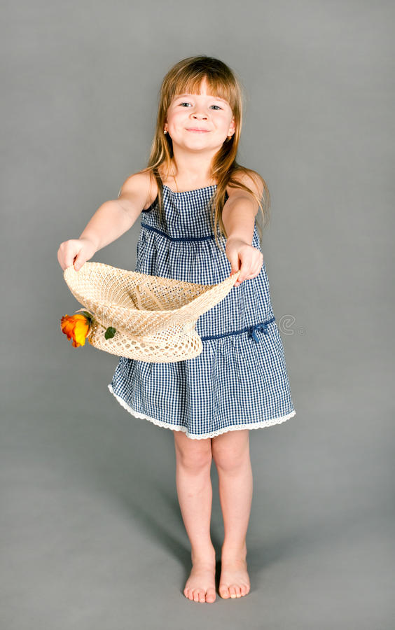 Download Little Girl In A Dress With A Straw Hat Stock Photo - Image: 20444562