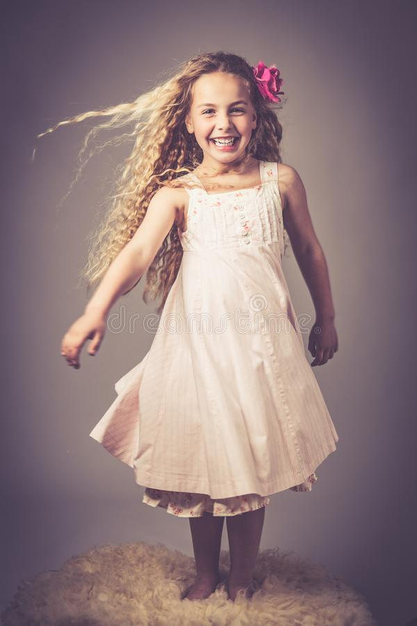 Little girl with a dress stock images