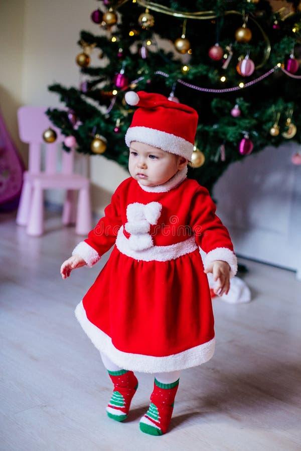 Little girl in santa costume stock images