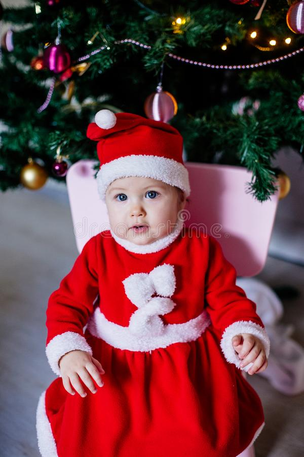 Little girl in santa costume royalty free stock photography