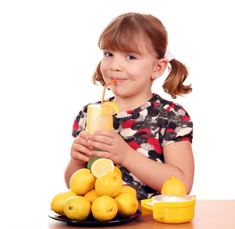 Download Little girl drink lemonade stock photo. Image of white - 27815236