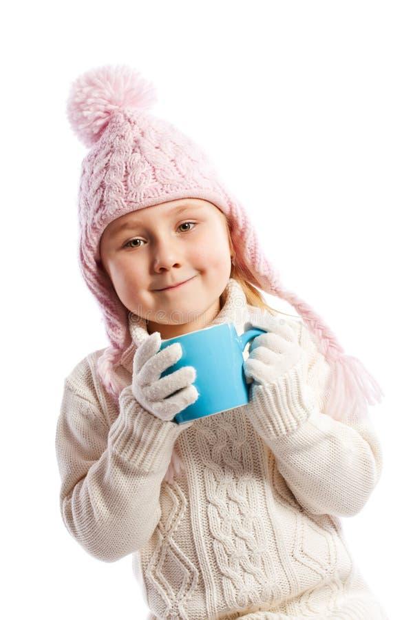 Little girl drinking hot beverage. stock images