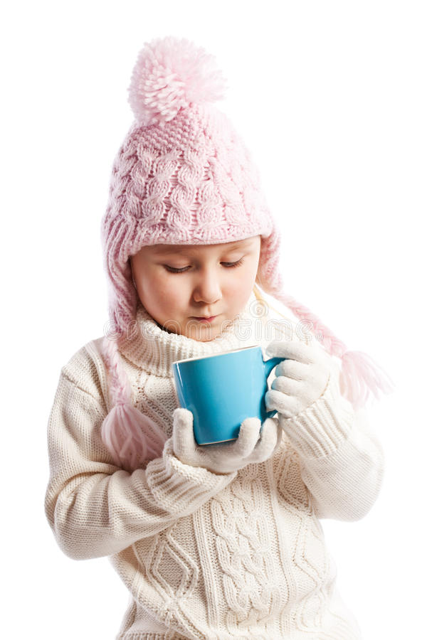 Little girl drinking hot beverage. royalty free stock photos